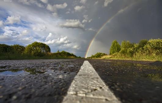 Фотообои Небо после дождя с радугой упирающейся в дорогу