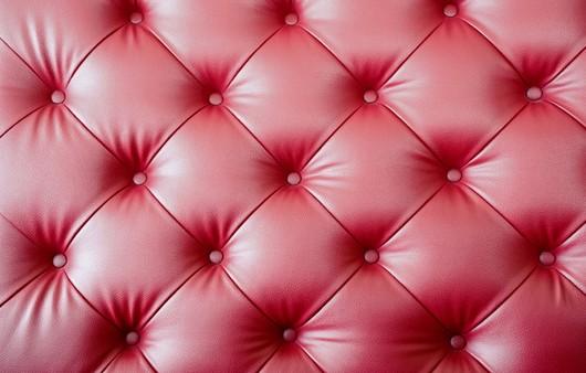 Текстура кожаного красного дивана