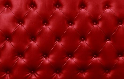 Текстура с кожаным красным диваном