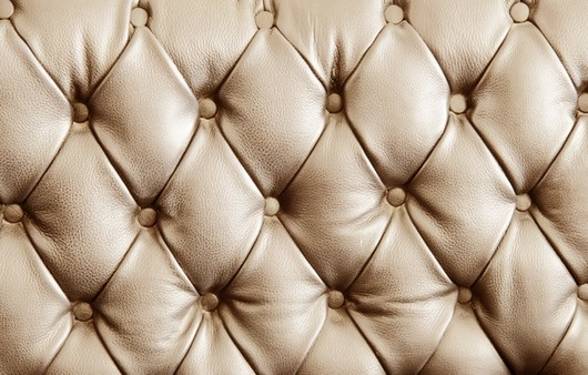 Текстура кор бежевого кожаного дивана