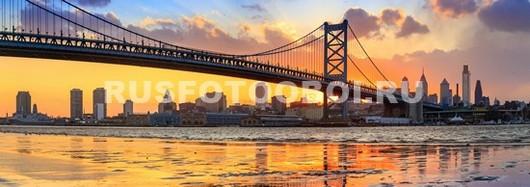 Закат под мостом в Нью-Йорке