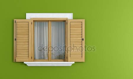 Деревянные окна на зеленой стене